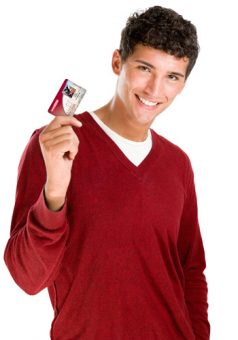 Smiling young man with credit card